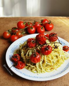 Vegan creamy avocado pasta with roasted cherry tomatoes