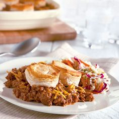 Sloppy Joe Casserole aka Manwich Casserole at my house. I use 1 pound of 93% lean ground beef, 1 can of Manwich Bold, 1 can of Grand Jr Flaky Layer biscuits, 1/2 -3/4 cup finely shredded cheese of choice. I stand the biscuit halves all over the top of the meat mixture and cover with cheese before baking. Everyone here loves it!