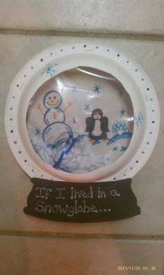 Snow globe writing prompt.  To make snow globe, put hole paper punch confetti into a zip lock and staple between two paper plates (cut the center out of one plate first)