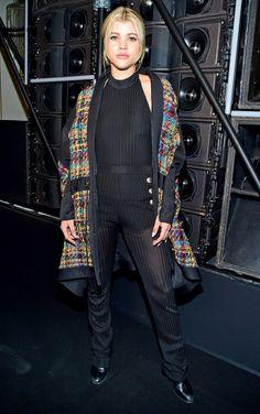 Sofia Richie in a black Balmain jumpsuit and vest