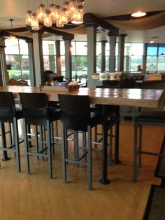 Wood plank table and modern bar stools at Tomato Pie Cafe Harrisburg. Love the combination!