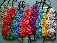 flora  silk yoyo headband pick a color by cookoorikoo