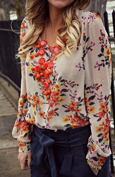 Enhance a floral top with a bold necklace with a similar color for a vibrant look!