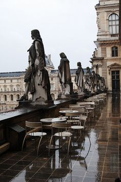 INTRIGUING ARCHITECTURE - DDO:) This travel photo is very much one of my MOST POPULAR RE-PINS - http://www.pinterest.com/DianaDeeOsborne/intriguing-architecture/ -   Few photos of the Musée du Louvre in Paris, France show this view of the elegant statues of people looking out upon the city from the restaurant patio deck. Notice the lovely reflections of the statues and building, reflecting off the wet rain-soaked floor.