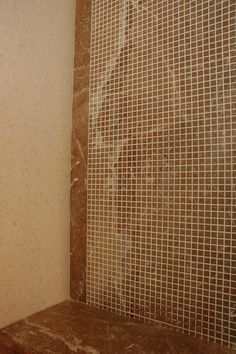 Wall cladding in spa with rojo alicante marble &mosaic