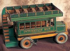 Lithographed tin mechanical - Interstate Bus -circa 1920s, by the Strauss Company.