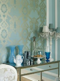 Love the shimmery damask wallpaper.