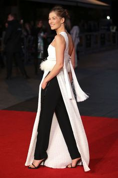 Rosamund Pike | An arch yet twisted glamour ruled the red carpet and the front row, enlivened with feathers, florals, and ruthlessly chic ruffles.