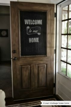 our vintage home love: Front Door Transformed Our exact door, painted to look like wood with chalkboard Welcome. Possibility. I hate my door.