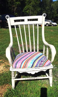 Recovered and refinished antique chair in bright colors