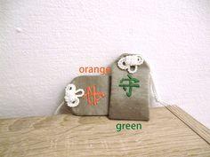 our talismans. 守 o-mamori www.o-mamori.com #talisman #organic #colours #colourful #orange #green #labeltag #hempsilk #lawofattraction #shineyourlight #youareawesome #changetheworld #omamori