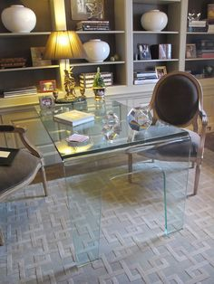 love the position of the lucite desk... great as a workspace but also a game table!