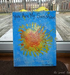 Kids' handprints make the sun. Frame it and hang it!
