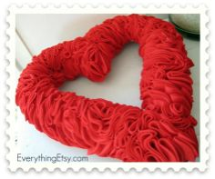 "Valentine's Day wreath.  Just need 12"" foam wreath, felt, glue, a bit of wide ribbon and LOTS of pins!"