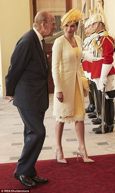 The fashion-loving Spanish Queen's lace trim dress and coat are believed to be by Felipe Varela, her go-to designer for big occasions such as this