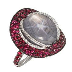 Katherine Jetter Grey Star Sapphire Ring 28.54ct grey star sapphire with red spinel and white diamonds and color change garnets set in 18k white gold