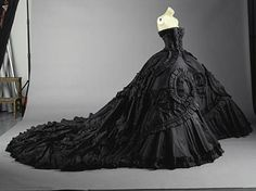 Ball gown: Maria Luisa (dite Coré) Black silk taffeta with self-fabric ruched ribbon appliqué.  French, spring/summer 1998.  Christian Dior Haute Couture by John Galliano  The Metropolitan Museum.  (My inner goth princess is still in love with this gown)