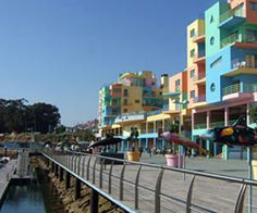 The colourful apartments and dolphin statues at Albufeira Marina