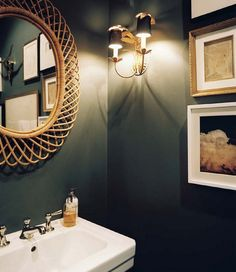 love the mirror and the dark, rich wall color. it's a powder room - why not?