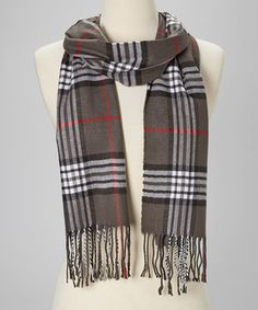 Liven up a lackluster look with this style-savvy scarf. Perfect for spicing up any ensemble, this lightweight layer boasts an eye-catching plaid pattern and a sumptuously soft cashmere construction.