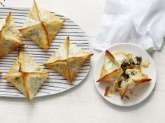 Spanakopita Hand Pies : You'll fall in love with these mini Greek pastries, which are wrapped in flaky phyllo dough and filled with a mixture of creamy potatoes, cheese, leafy greens and plenty of herbs.