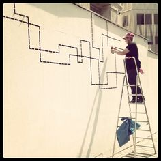 The artist Nick Prokesch alias nic. has studied video/video installation at the Academy of Fine Arts Vienna. With his tape graffiti Nick produces architecture in 2D perspective. Taped comics or abstract oeuvres are structuring walls, floors and stairs. Nick's work is taped with rubber tape instead of being sprayed or painted. #kufoklebt #art #vienna #graffiti #comic #kunstforum Linear Art, Tape Art, Video Installation, Vienna, Sculpture Art, 2d, Floors, Perspective, Graffiti
