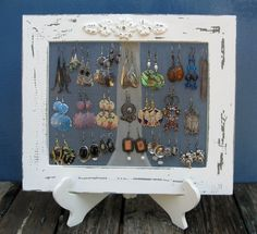 Use a picture frame without the backing, add screen, and place on a stand to create earring holders.
