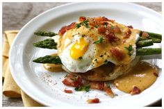 eggs benedict with bbq hollandaise..i don't know if i agree with this, but the presentation is delicious.