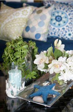 Beach House Sofa Table:  Starfish, sand dollar and bouquet on a narrow silver tray, by Darci Goodman.