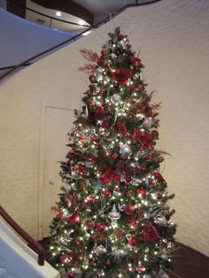An elegant red and silver Christmas tree complements the red and white spiral staircase. Located in Grey Rock restaurant at Heidel House Resort & Spa during the 2012 season.