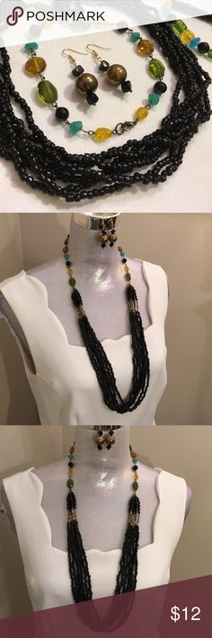 """Long Black Beaded Necklace with Glass Beads You get everything pictured. I made the earrings and bracelet. Necklace has an antique Gold """"tarnished """" Finish. Seven strands of hall Black beads. Colorful beads that are around the neck are also glass. Necklace is 35"""" long. Earrings are two inches long. Bracelet is strung on Elastic cord. Boutique Jewelry Necklaces"""