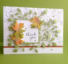 "Hi everyone. Hope you're enjoying your weekend! I love Fall with all of its beautiful colors, and I have a pretty simple card with a Fall theme to share with you today. The A-2 card base is cut from white card stock. I embossed a separate piece of white card stock cut at 5.5"" x 3.5"", adhered a strip of rust card stock along the bottom edge, and then glued the assembled piece to the card base. I cut one Massa Leaf Frame from green card stock and shaped some of the leaves to make them pop. I…"