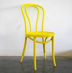 Yellow Thonet chair, just scored a vintage one for 2 dollars!! I painted it yellow, but now I want it to be hot pink.....