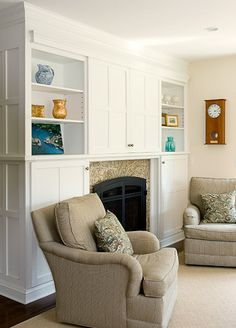 TV hiden above the fireplace and the doors slide open over the bookcases...cleaver