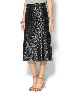 """Sabine Midi Sequin Skirt. Midi length skirt. Allover sequins. Sits at waist. Hidden back zipper. Lined. Imported. Model is 5'9, wearing a size S . Length: 30""""."""
