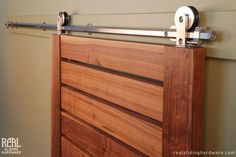 slatted barn door with modern stainless hardware