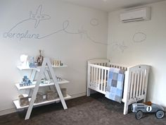 Aeroplane - A pastel blue, vintage themed nursery for our client Jesse. We think that he will absolutely love his kid sized miniature vintage race car. Baby boys nursery interior designs by Little Liberty