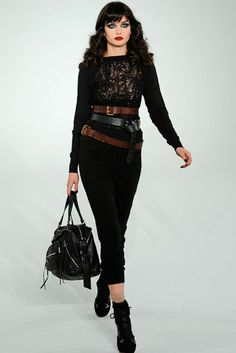 Goth drama- long, black, fitted dress with lace panel, lots of belts and bitch make up