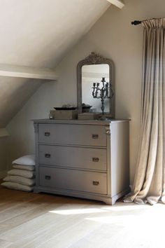 pretty grey chest of drawers and gorgeous curtains