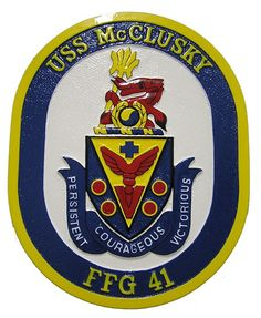 USS McClusky (FFG-41), an Oliver Hazard Perry-class frigate, is a ship of the United States Navy named for Rear Admiral C. Wade McClusky who's achievements during the Korean War, for which he was awarded the Legion of Merit, and his distinguished service as Chief of Staff of the Seventh Fleet during that period, are indicated by the wreath and the Neptune spear of seven barbs, respectively. The gold and blue taeguk and the red dragon refer to Korea.
