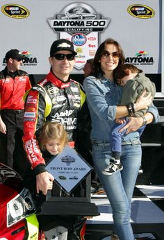 DAYTONA BEACH, FL - FEBRUARY 17: Jeff Gordon, driver of the #24 Drive To End Hunger Chevrolet, poses for photos with his wife Ingrid Vandebosch and children Ella Sofia and Leo after qualifying for the NASCAR Sprint Cup Series Daytona 500 at Daytona International Speedway on February 17, 2013 in Daytona Beach, Florida. (Photo by Jerry Markland/Getty Images)
