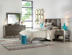 From the Bravo Collection. Casual style bedroom group made in a Smoked Oak finish. Start your day off on the right foot with a bedroom collection that reflects your style.