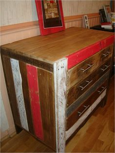 This cabinet was done with wooden pallets.