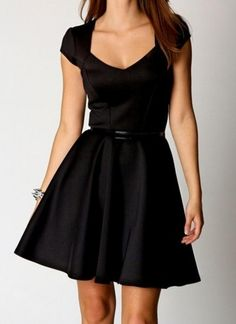 Sweetheart neck black skater dress, perfect for casual, day work wear. it has a sexy sweetheart neckline with short cap sleeves. This stunning dress nips you in at the waist, and has a full swirly skater skirt for a super feminine look.