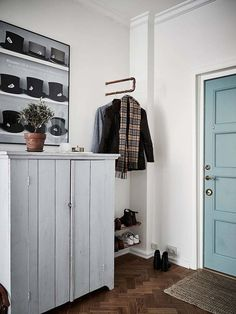 I love the simplicity of this. copper pipe for hanging shoes and coats! :)