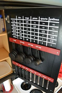 Looking to better organize your kitchen? Utilize the inside of a cabinet door to organize measuring cups and spoons and add a vinyl measurement conversion chart above it!