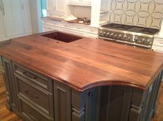 Reclaimed walnut satin finish counter top with copper sink. #reclaimedlumber #barnwood http://www.eaglereclaimedlumber.com/