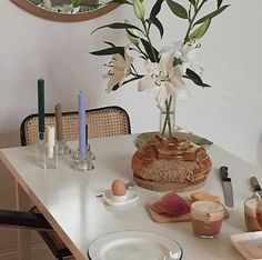 Such a lovely tablescape. I love the lilies, the woven chairs, the candesticks, all of it. Interior And Exterior, Interior Design, Kitchen Interior, Ideas Para Organizar, Humble Abode, Decoration, Interior Inspiration, A Table, Kitchen Dining