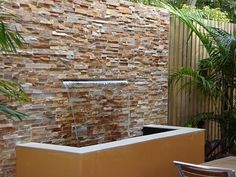Stacked Stone with Sheer Descent.This stacked stone wall with sheer descent of water creates a relaxing, tropical feel to the alfreso area of the Beerwah Hotel. Stacked stone comes in numerous colours to complement your landscaped areas.