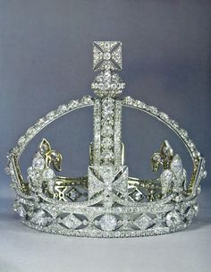 QUEEN VICTORIA'S SMALL DIAMOND CROWN, 1870. Created on the order of the queen to serve as a substitute for the heavy Imperial State Crown; also, it was easy to wear with her widow's veil. Despite it's tiny size it contains over 1,000 diamonds, the queen providing most of the stones taken from various unused royal jewels in her collection. Her grandson George V gave the crown to the State and it has since remained in The Tower of London. Queen Alexandra and Queen Mary wore the jewel…